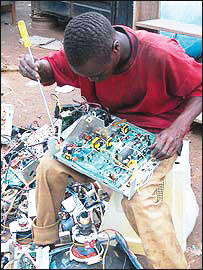 A technician fixing a damaged computer