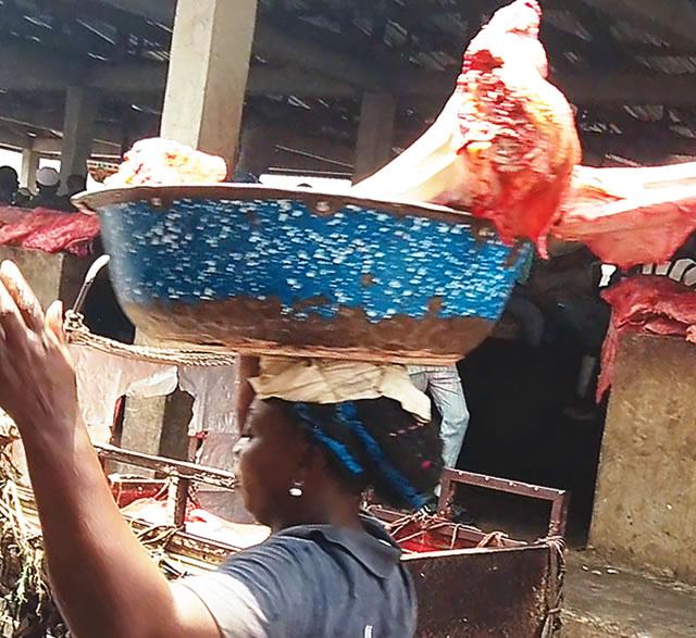 A meat buyer in Lagos abattoir