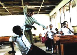 A teacher flogging a pupil